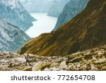 man hiking in mountains... | Shutterstock . vector #772654708
