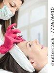 young pretty woman receiving...   Shutterstock . vector #772676410