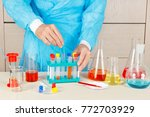 chemist doing chemical research ... | Shutterstock . vector #772703929