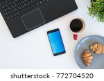 high angle shot of items on a... | Shutterstock . vector #772704520