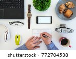 high angle shot of items on a... | Shutterstock . vector #772704538