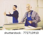two positive men in coverall... | Shutterstock . vector #772713910