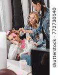 women glue stickers on sleeping ... | Shutterstock . vector #772730140