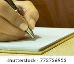 taking notes on a notebook | Shutterstock . vector #772736953