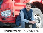 happy driver next to his lorry | Shutterstock . vector #772739476