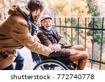 senior father in wheelchair and ... | Shutterstock . vector #772740778