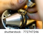 jeweler working on a ring | Shutterstock . vector #772747246