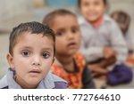 happy rural kids sitting on... | Shutterstock . vector #772764610