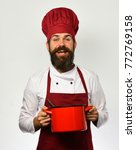 man with beard holds red pot on ...   Shutterstock . vector #772769158