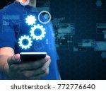 hand holding smart phone...   Shutterstock . vector #772776640