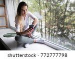 woman using cell phone at home... | Shutterstock . vector #772777798