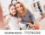 mom and daughter are cooking... | Shutterstock . vector #772781203