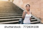 young attractive woman visiting ... | Shutterstock . vector #772834108