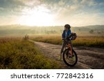 Boy Rides A Bicycle In The...