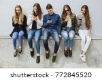 group of smiling teenagers with ... | Shutterstock . vector #772845520