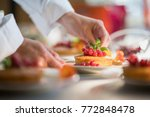 close up on the hands of the... | Shutterstock . vector #772848478