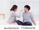 cute asian couple sitting on... | Shutterstock . vector #772851670