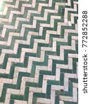 Small photo of Green and white chevron patterned floor tiles in Marrakech, Morocco