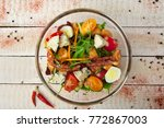 salad with vegetables and cheese | Shutterstock . vector #772867003