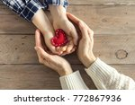 red heart in child and female...   Shutterstock . vector #772867936