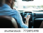 man using phone while driving... | Shutterstock . vector #772891498