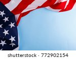 the american flag lies on the... | Shutterstock . vector #772902154
