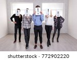 a group of people stand with an ... | Shutterstock . vector #772902220