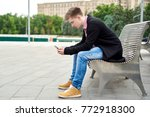young man with smartphone...   Shutterstock . vector #772918300