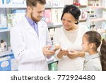 male pharmacist helping his... | Shutterstock . vector #772924480