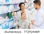Small photo of Cute young girl asking harmacist about medicine at the drugstore while shopping with her mother consultation kids children positivity happiness parenting professional trustworthy experienced doctor