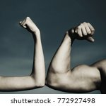Small photo of Muscular arm vs weak hand. Vs, fight hard. A heavily muscled man arm wrestling a puny weak man. Competition, strength comparison. Health concept. Hand, man arm, fist. Close-up. Black and white.