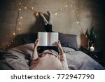 cropped shot of woman lying on... | Shutterstock . vector #772947790
