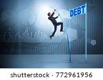 businessman pole vaulting over...   Shutterstock . vector #772961956