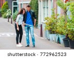 young tourist couple looking at ... | Shutterstock . vector #772962523