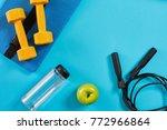 dumbbells  bottle of water and...   Shutterstock . vector #772966864
