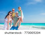 young family of four on beach... | Shutterstock . vector #773005204