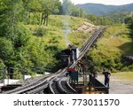 Small photo of Mount Washington Cog Railway, New Hampshire - September 2008: Scenic view of a steam engine starting its ascent to the summit