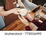 the girl picks up a coffee from ... | Shutterstock . vector #773016490
