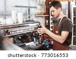 a young guy barista works at... | Shutterstock . vector #773016553