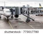 Small photo of Stockholm, Sweden- October 13th 2017:Travellers boarding an airbus aircraft along an airbridge