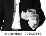 business man holding money on...   Shutterstock . vector #773027869