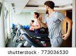 people running on treadmill in... | Shutterstock . vector #773036530