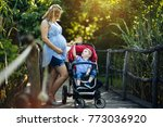 pregnant woman with her child...   Shutterstock . vector #773036920