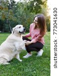 photo of woman with dog on lawn ... | Shutterstock . vector #773041630