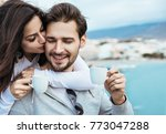 young couple in love drinking... | Shutterstock . vector #773047288