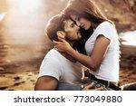 handsome man hugging his woman... | Shutterstock . vector #773049880