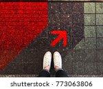 red arrow on street and sneaker ... | Shutterstock . vector #773063806