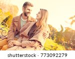 young couple walk in the autumn ... | Shutterstock . vector #773092279