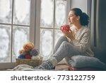 beautiful young woman sitting... | Shutterstock . vector #773122759