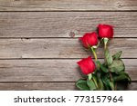 Stock photo valentines day greeting card red roses on wooden table top view with space for your greetings 773157964